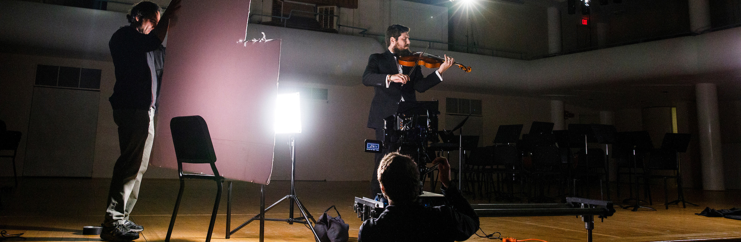 Videographers film a violinist